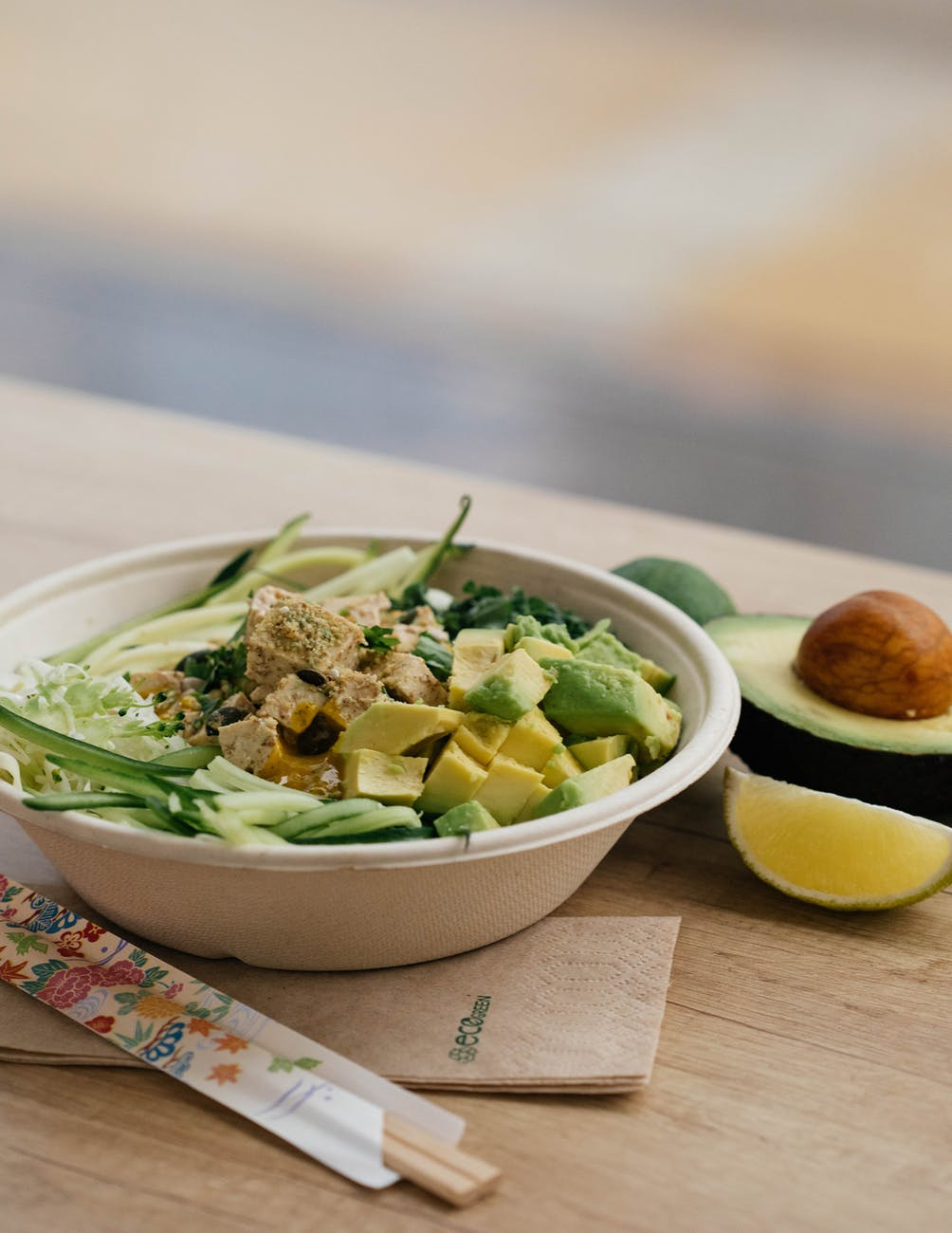 salad with sliced avocado in bowl